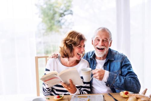 elderly coupe having breakfast